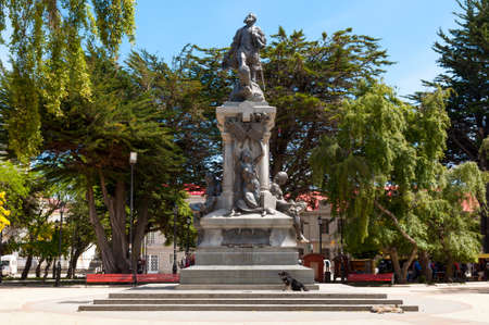 touch base: Punta Arenas, Chile - December 9, 2012: Monument to Fernando de Magallanes. Locals and tourists come to touch or kiss the feet of the Indian who is reclining on the stone base of the monument, the legend says that the person who does, will return to Punta