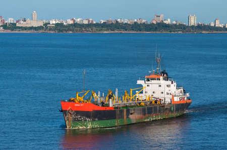 Montevideo, Uruguay - December 15, 2012: Trailing Suction Hopper Dredger Draga D-7 in the Port of Montevideo, Uruguay. Montevideo has a natural port, with the enough dredging to allow cargo ships dock comfortably.