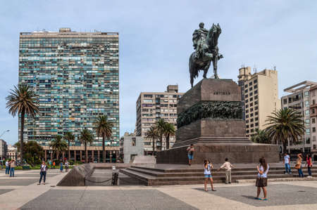 artigas: Montevideo, Uruguay - December 15, 2012: Plaza indepedencia with the statue of Jose Artigas in Montevideo, Uruguay. People can be seen in the image.