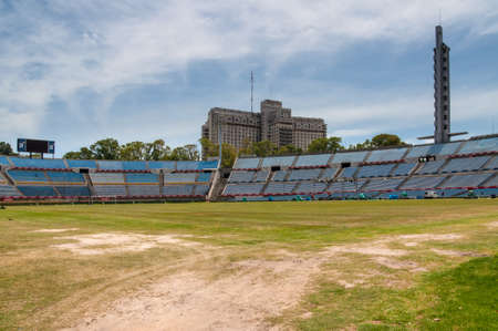 trampled: Montevideo, Uruguay - December 15, 2012: Trampled grass of the football field at the Centenario Football Stadium, Montevideo, Uruguay - Built for the first World cup in 1930 the stadium is the home of the Uruguayan football team and used by Penarol FC for