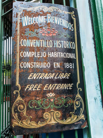 la boca: Buenos Aires, Argentina - December 16, 2012: Street sign for the famous historic tenement housing complex built in 1881 in La Boca, Buenos Aires. The sign is attached to the gate at La Boca, Buenos Aires. Editorial