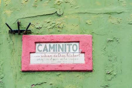 multi national: Buenos Aires, Argentina - December 16, 2012: Placard of famous place Caminito in Buenos Aires. The name of Caminito is Inspired on the song of Juan de Dios Filiberto is written on the board in Buenos Aires, Argentina.