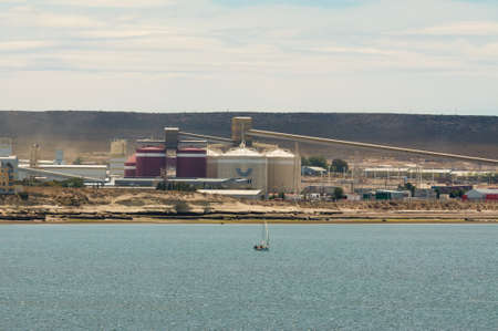 smelter: Puerto Madryn, Argentina - December 13, 2012:  Aluminium smelter Aluar Aluminio Argentinosat at Puerto Madryn, Patagonia, Argentina.