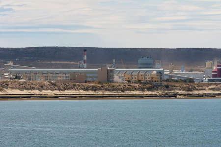 puerto: Puerto Madryn, Argentina - December 13, 2012:  Aluminium smelter Aluar Aluminio Argentinosat at Puerto Madryn, Patagonia, Argentina.