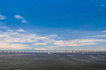 urban sprawl: Rio Niteroi Bridge in Guanabara Bay, Rio de Janeiro, Brazil. Stock Photo