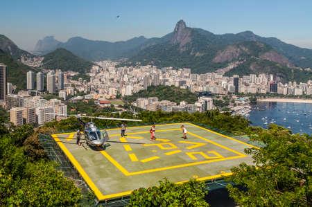 december 21: Rio de Janeiro, Brazil - December 21, 2012: Tourists enjoying the Helicopter aerial tour from Sugarloaf Mountain in Rio de Janeiro, Brazil. Editorial