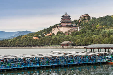 mid distance: Beijing, China - October 14, 2013: The Summer Palace of emperors from dynasties of the past - Beijing, China. Tourist boat in the foreground. Editorial