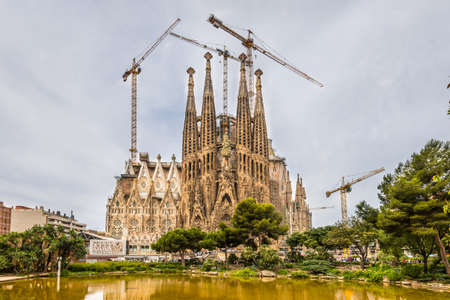 rebuilt: Barcelona, Spain - May 18, 2014: Sagrada Familia Temple rebuilt and reconstructed in cloudy weather - Barcelona, Spain.