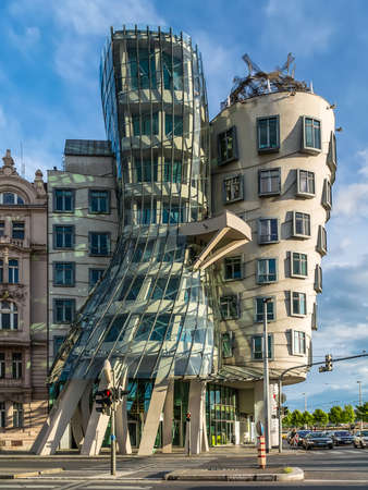 dancing house: Prague Czech Republic - May 11, 2014: The Dancing House, Prague, Czech Republic, Europe. Others have nicknamed it Drunk House. The building was designed by Vlado Milunic and Frank Gehry in 1992 and completed in 1996. Originally named Fred and Ginger the