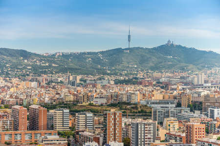 high up: Barcelona, Spain - May 18, 2014: The view of Barcelona from high up in the Renaissance Barcelona Fira Hotel. Visible on the horizon television tower Collserola and Temple of the Sacred Heart of Jesus.
