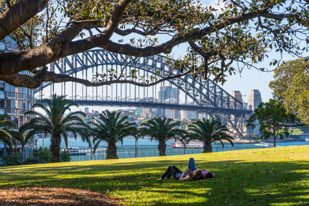man made structure: Sydney, Australia - November 7, 2014: Just relax in park and enjoy the one of the famous bridges of the world, Sydney, NSW, Australia. Editorial