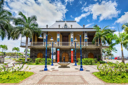 joe louis: Port Louis, Mauritius - December 25, 2015: Exterior of the Blue Penny Museum. It is a stamp museum at Caudan Waterfront in Port Louis, the capital of Mauritius. The museum collection includes the 1847 Blue Penny and Red Penny stamps.