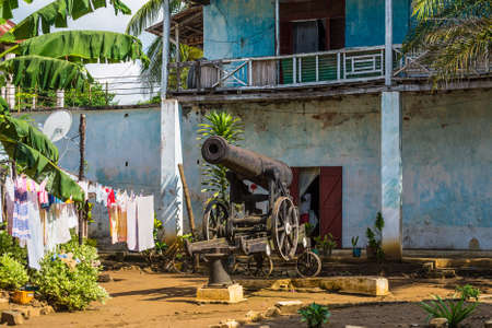 squadron: Hell Ville, Madagascar - December 19, 2015: Old cannon in the courtyard of an apartment house in the town of Hell Ville, Nosy Be Island, Madagascar. In 1904 - 1905 the Imperial Russian squadron stayed in Nosy Be for four months on the road to war with Jap Editorial