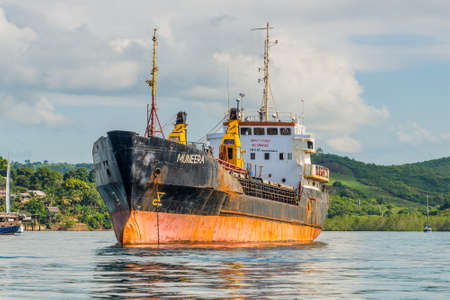 seized: Hell-Ville, Madagascar - December 19, 2015: General Cargo Ship Muneera (formerly known as Semlow) anchored at Hell-Ville, Nosy Be Island, Madagascar. On 2005 pirates seized control of MV Semlow as it was ferrying 850 tonnes of German- and Japanese-donated Editorial