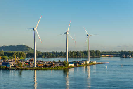 producing: Victoria, Mahe island, Seychelles - December 15, 2015: Wind turbines producing clean electricity at dawn in Victoria, Mahe Island, Seychelles. Editorial
