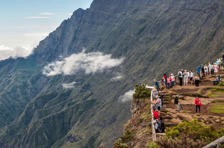 incidental people: Piton Maido, La Reunion Island, France - December 24, 2015: Tourists on the Maido lookout overlooking Cirque of Mafate, listed as World Heritage by UNESCO, La Reunion Island, France.