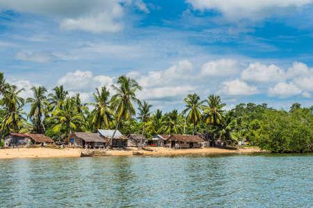 dugout: Ambatozavavy, Nosy Be, Madagascar - December 19, 2015: Traditional fishing village Ambatozavavy with wooden dugout rowing vessels on the island of Nosy Be, Madagascar.