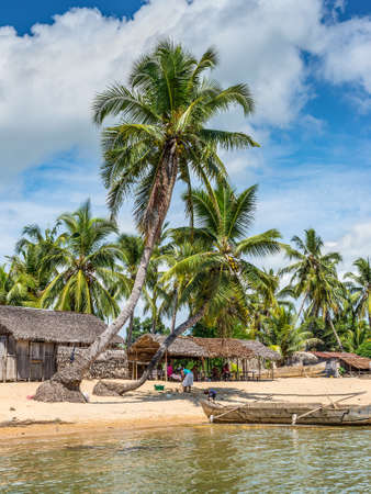 nosy: Ambatozavavy, Nosy Be, Madagascar - December 19, 2015: Malagasy typical village on the beach in Nosy Be island, north of Madagascar.