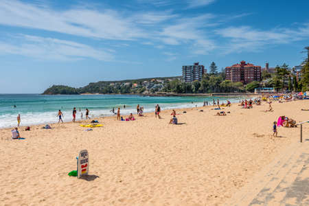 sightseers: Sydney, Australia - November 9, 2014: Manly Beach on a sunny, sunday morning, with tourists and sightseers enjoying the water, Sydney, Australia. People having fun on Manly beach.