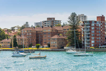 manly: Manly, Australia - November 9, 2014: Sailboats moored in the Manly district bay on Summer day, near Sydney, Australia. Manly is a beach-side suburb of northern Sydney, in the state of New South Wales, Australia.