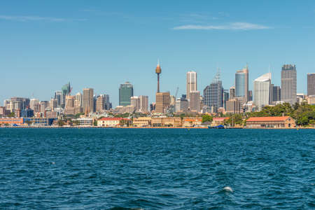 Sydney, Australia - November 9, 2014: Water front panorama of Sydney Central Business District office buildings showing centrepoint tower, Sydney, New South Wales, Australia. The Garden Island dockyard in the foreground. Editorial