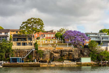 holiday house: Sydney, Australia - November 10, 2014: Chiswick waterfront houses on the banks of the Parramatta River in cloudy weather, Sydney suburb, New South Wales, Australia. Editorial