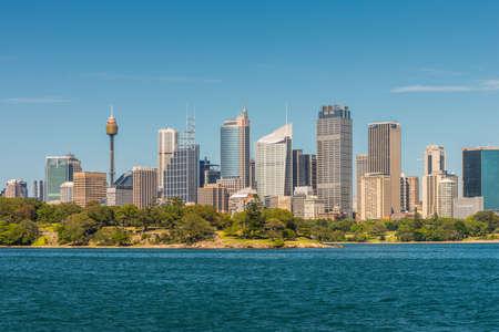 high rises: Sydney, Australia - November 9, 2014: Australian Sydney landmark - city CBD high rises and towers forming megapolis cityscape summer day from harbour, Sydney, New South Wales, Australia.