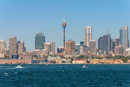 high rises: Sydney, Australia - November 9, 2014: Australian Sydney landmark - city CBD high rises and towers forming megapolis cityscape summer day from harbour, Sydney, NSW, Australia.