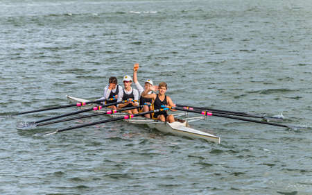sculling: Sydney, Australia - November 10, 2014: Rowing team rowing scull on the Parramatta River, Sydney suburb, New South Wales, Australia.