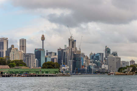 resonating: Sydney, Australia - November 10, 2014: View of the Barangaroo Reserve on a cloudy day. Barangaroo is an inner-city suburb of Sydney, New South Wales, Australia. Barangaroo Reserve is Sydneys newest harbourside park, resonating with Aboriginal significanc
