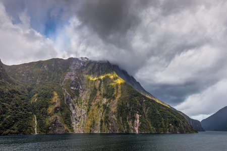 mitre: Landscape of Milford Sound Fjord in New Zealand after heavy rain. The picture was taken from a ship. The water is on the foreground and the mountains are in the background at Milford Sound, New Zealands South Island. Stock Photo