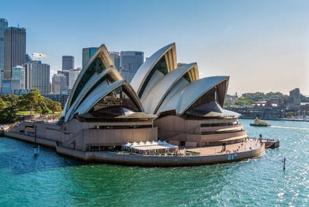 Sydney, Australia - November 12, 2014: Sydney Opera House view from a cruise ship in Sydney, Australia. The Sydney Opera House is a famous arts center. It was designed by Danish architect Jorn Utzon, finally opening in 1973.