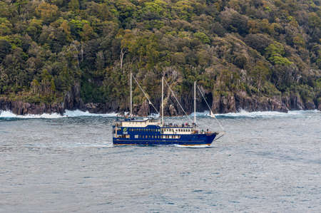 mariner: Milford Sound, New Zealand - November 14, 2014: The Milford Mariner Ship cruising in Milford Sound Fjord, New Zealand. This fiord is considered as one of the most scenic places in the world.