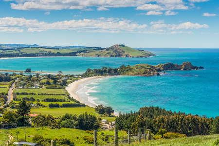 Karitane coastline, Huriawa Peninsula in the center (Historic Maori Pa Site), Karitane near Dunedin Otago South Island New Zealand
