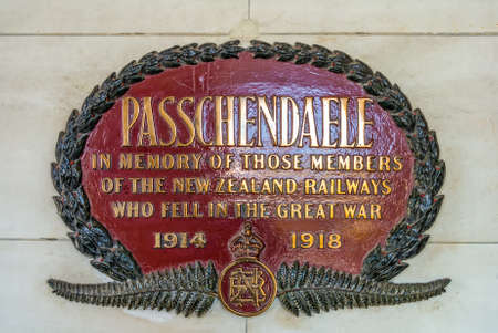 social history: Dunedin, New Zealand - November 16, 2014: The Passchendaele memorial plate at Dunedin railway station, New Zealand. The plate commemorates 56 members of the Dunedin section of New Zealand Railways (NZR) who lost their lives during the First World War.
