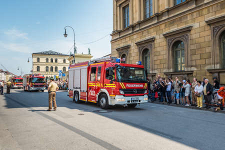 cele: Munich, Germany - May 29, 2016: Munich saw the biggest fire truck parade the world has ever seen (still to be confirmed by the Guinness Book of World Records) and tens of thousands came out to see the parade. The huge Firetage Parade was organised to cele