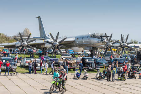 aerospace industry: Kyiv, Ukraine - April 26, 2015: Strategic bomber Tu-95 Bear is in the State Museum of Aviation.People walk viewing the exhibits of the festival Old Car Fest 2015 at April 26, 2015 in Kiev, Ukraine.