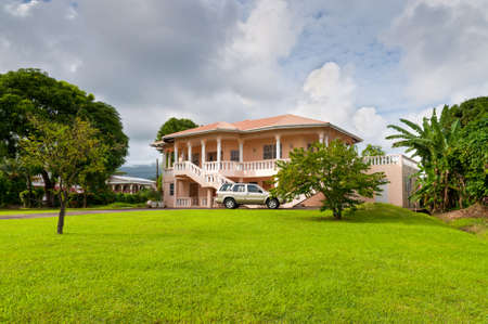 upper class: St. Georges, Grenada - December 3, 2011: Luxury mansion in exclusive part of St. Georges, Grenada at December 3, 2011. Editorial