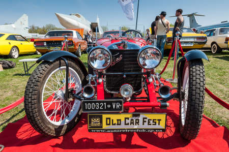 Kyiv, Ukraine - April 26, 2015: The festival Old Car Fest 2015, showed an elegant red 1949 Fiat Roadster vintage model at April 26, 2015 in Kiev, Ukraine. Fiat S.p.A. is an Italian automobile manufacturer, engine manufacturer, financial and industrial g