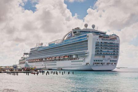 the emerald city: Kralendijk, Bonaire - December 2, 2011: International Cruise Ship Emerald Princess anchored at Kralendijk the capital and largest city of the island Bonaire, Netherlands Antilles.
