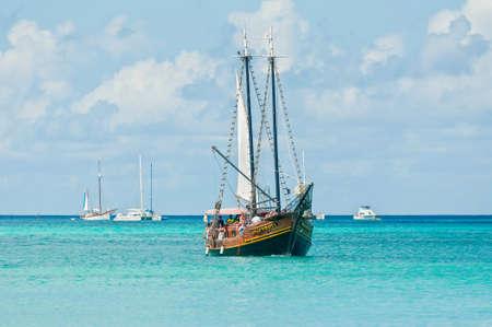 aruba: Oranjestad, Aruba - December 01, 2011: Tourists sailing aboard Jolly Pirates along the coastline and enjoy the beautiful tropical island of Aruba at December 01, 2011.