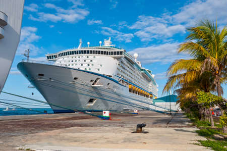 warm climate: Oranjestad, Aruba - December 1, 2011: Moored cruise ship Adventure of the Seas waiting for passengers at December 1, 2011. Editorial
