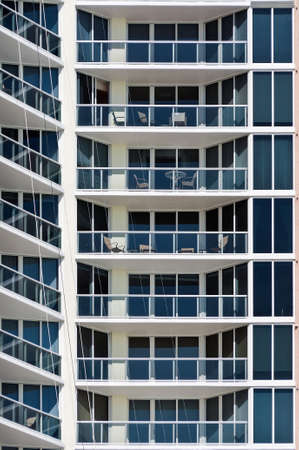 detailed shot: New Modern apartment house - this is a vertical, color photograph of a high rise, Miami Beach apartment building. The detailed shot shows the repetition of balconies.