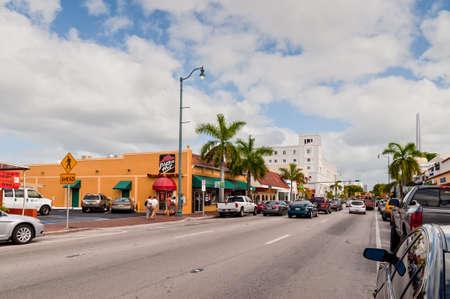 miami florida: Miami, Florida, USA - November 25, 2011: Tourists go toward the popular Calle Ocho, in Little Havana, Miami, Florida, USA. Calle Ocho is the heart of the exiled cuban american community.