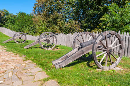 Old Cossack cannons with wooden wheels are still on duty in the ancient wooden citadel in Baturin, Ukraine. Citadel of Baturin Fortress on river Seim, in years 1669-1708 was residence of three Ukrainian Hetmans: Demian Mnohohrishny, Ivan Samoilovych and I