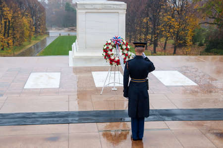 Arlington, USA - November 16, 2011: Soldier salutes - changing the guard in the afternoon at the grave of the unknown soldier at the cemetery of Arlington in Washington, USA Editorial