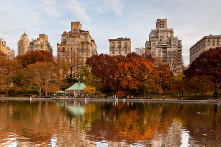 New York City, USA - November 14, 2011: A people sailing a model boats at the Conservatory Water in New Yorks Central Park at November 14, 2011. Central Parks pond is popular with tourists who rent radio-controlled sailboats, one lever on the controls t
