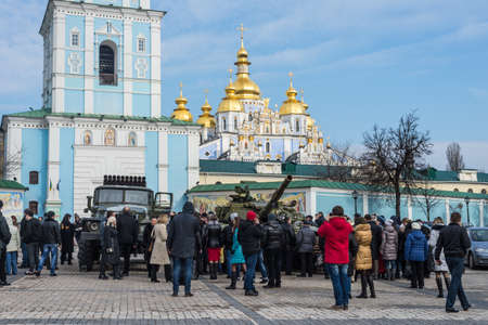 expose: Kiev, Ukraine - February 25, 2015: People visiting the documentary exhibition Presence. Evidence of the Russian Military Aggression on the territory of Ukraine. Exhibition items also expose the groundless nature of the Russian myth that there is a civil