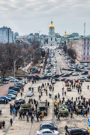 Kiev, Ukraine - February 25, 2015: People visiting the documentary exhibition Presence. Evidence of the Russian Military Aggression on the territory of Ukraine. Exhibition items also expose the groundless nature of the Russian myth that there is a civil