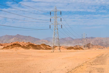 'power line': Desert power line and electricity pylons